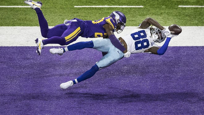 Dallas Cowboys wide receiver CeeDee Lamb hauls in a touchdown pass during the Cowboys' 31-28 win over the Minnesota Vikings Sunday in Minneapolis. With the win, Dallas is a 1/2 game out of first place in the NFC East.