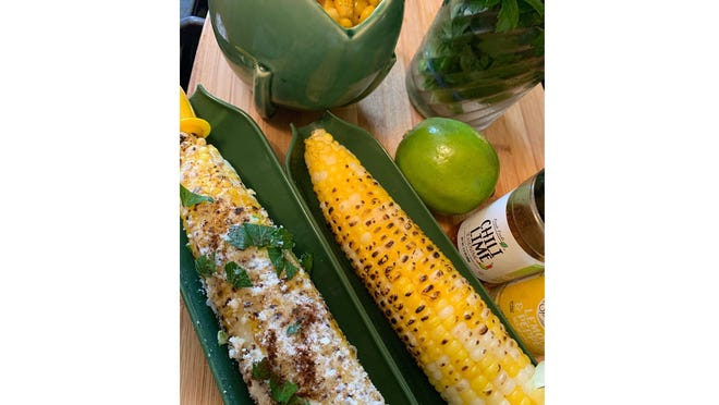 Mexican street corn and salad can be served with various accompaniments, such as lime, cilantro or hot peppers.