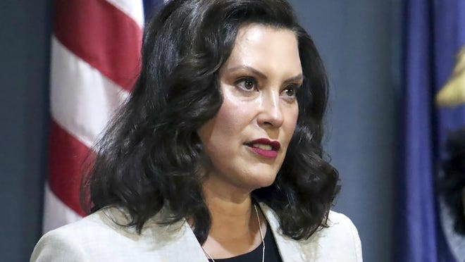 In a file photo provided by the Michigan Office of the Governor, Michigan's Democratic Gov. Gretchen Whitmer addresses the state during a speech in Lansing. Whitmer has extended Michigan's coronavirus emergency through Sept. 4, enabling her to keep in place restrictions designed to curb COVID-19.