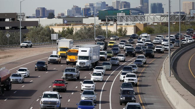In this Jan. 24, 2020 file photo, early rush hour traffic rolls along I-10 in Phoenix. The U.S. government's road safety agency is offering a smartphone app that will alert drivers if their vehicles are recalled. The National Highway Traffic Safety Administration was to roll out the app for Android and Apple phones on Thursday, Aug. 27.