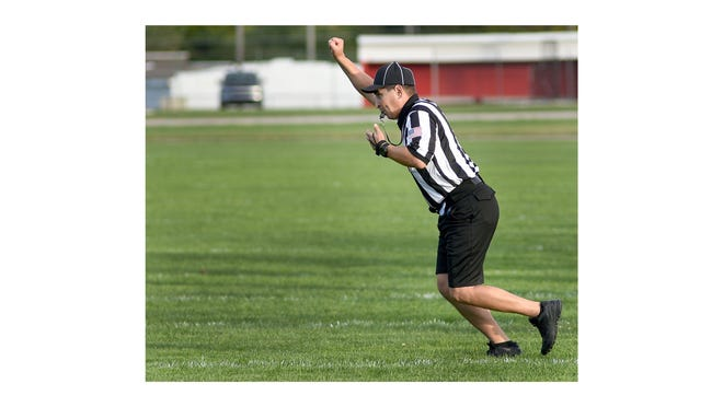 Clyde Canales of Temperance signals fourth down during a game in 2018. There is a shortage of football officials for this season.