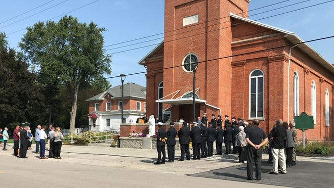 """Firefighters, friends and family stood in respect as Anthony J. """"Joe"""" Keane was honored with a Last Alarm service Saturday in Erie. Keane was a former deputy chief and interim chief of Bedford Township Fire Department."""