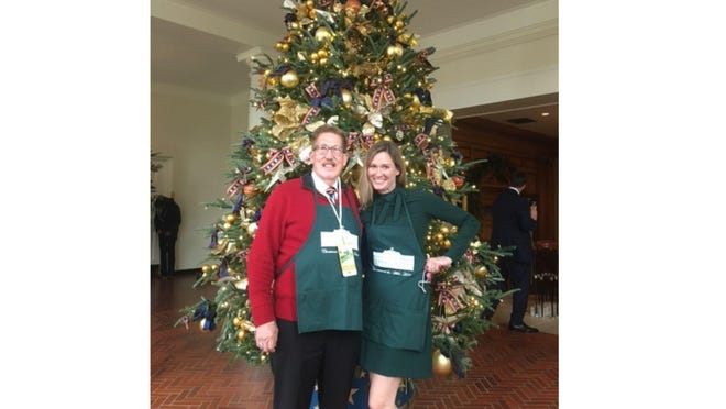 Mark Smith and his daughter Danielle Sims were among the volunteers selected to help decorate the White House for Christmas.