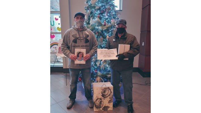 Brian and Lenny Books drop off ten donated iPads to ProMedica Monroe Regional Hospital in honor Julie Books, who died of COVID-19 complications last year. The iPads will be used to connect family members with patients who are unable to see visitors in person.