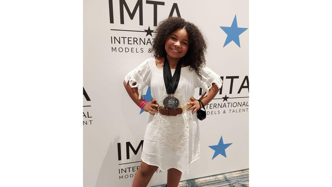 "Giavanna ""Gia"" Brooklyn Butler of Monroe poses during her participation earlier this month at the International Models and Talent Association convention in Orlando."