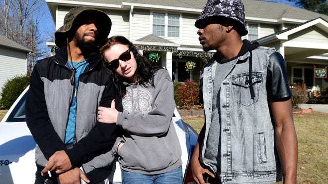 Kaswayne Forsythe, left, the brother of 19-year-old Swayne Forsythe, is comforted with friends Kaitlyn Short, center, and Money Caldwell at the Forsythe family home in south Asheville on Wednesday. Swayne Forsythe was found in a car in the French Broad River on Tuesday after being reported missing Dec. 29, 2014. Forsythe was found with 19-year-old Aida Bytyqi.