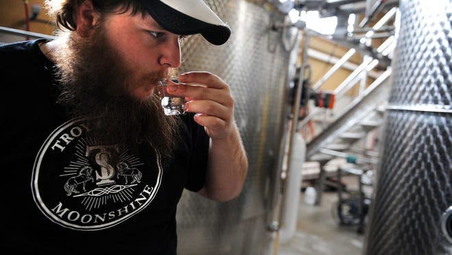 Senior distiller Joseph Ford of Asheville Distilling monitors a batch of moonshine Thursday. The distillery is at 12 Old Charlotte Highway next to Highland Brewing.