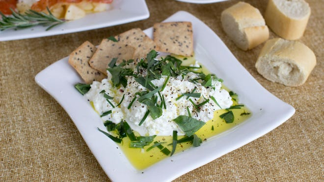 Sprinkle a variety of chopped herbs on fresh ricotta for a simple yet tasty appetizer.