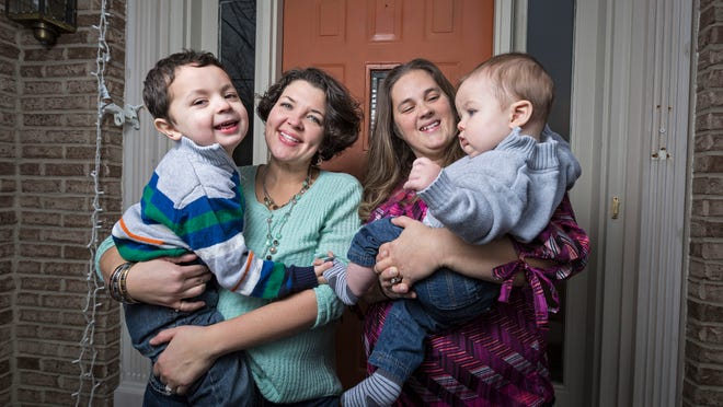 The Yorksmith family — plaintiffs Pam, 42, Nicole, 35, and their sons Grayden and Orion.. The couple are among several Cincinnati-area residents involved in a same-sex marriage case before the U.S. Supreme Court.