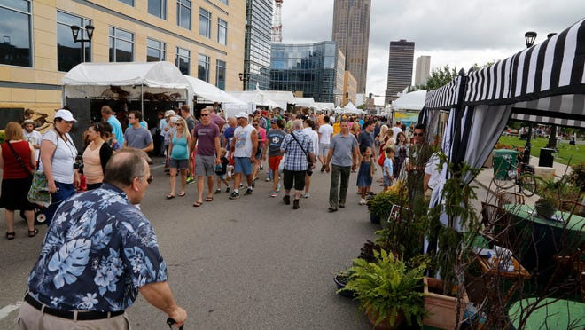Thousands of people attend the annual Des Moines Arts Festival in Western Gateway Park.