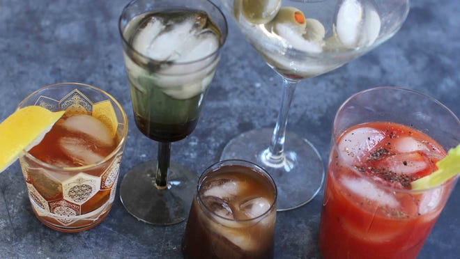 """Mixed cocktails, from left, are an old fashioned, a vodka gimlet, a Bull Shot, a dry martini and a Bloody Mary. """"The culture of the cocktail really exploded in the '60s,"""" says Maureen Petrosky, author of """"The Cocktail Club."""" Suddenly there were cocktail dresses, new glassware, bar couture, Tiki drinks. The cocktail hour had its own wardrobe."""