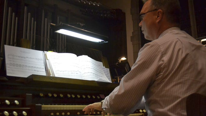 Jeff Verkuilen, organist at First United Methodist Church of Green Bay, plays an organ in the balcony of the downtown Green Bay church during the annual Interfaith Thanksgiving Worship service Tuesday night, Nov. 25.