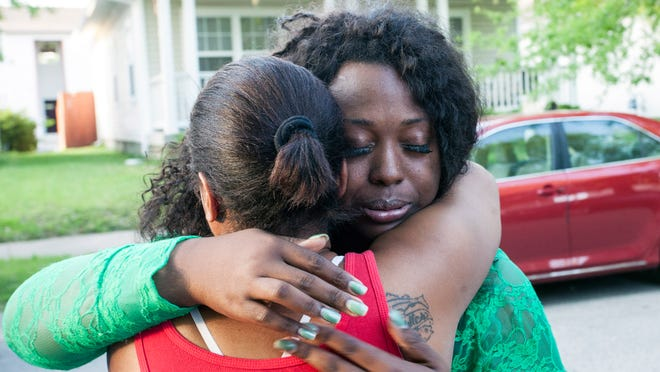 Jessica Green is embraced by a supporter after winning the Democratic primary for Metro Council District 1.