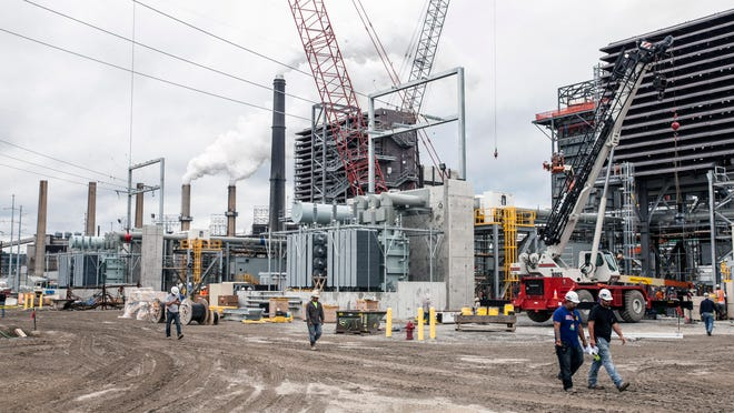 LG&E is building a new cleaner-burning natural gas power plant on the grounds of its Cane Run coal-fired plant, which it plans to retire.
