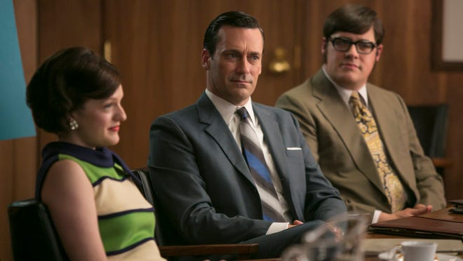 """In this image released by AMC, Elisabeth Moss, as Peggy Olson, from left, Jon Hamm, as Don Draper, and Rich Sommer, as Harry Crane, appear in a scene from the final season of """"Mad Men,"""" premiering Sunday, April 5, 2015, at 10 p.m. EDT on AMC. For the first time, """"Mad Men"""" and HBO's """"Game of Thrones,"""" which premieres April 12, will be available to so-called cord cutters _ legally. (AP Photo/AMC, Jaimie Trueblood)"""