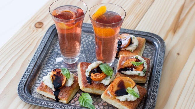 Spiced prosecco and honey broiled persimmon tarts.