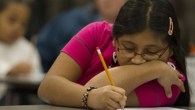 Delmy Hernandez, 11, preps for the ISTEP test at Crooked Creek Elementary School in Indianapolis in 2010. Indiana Department of Education officials released a new version of the ISTEP test that shortens it by three hours and five minutes.
