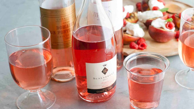 This June 2, 2014 photo shows from left to right, Domaine De Fontsainte, Scalabrone and Chateau Viranel rose wines in Concord, N.H.