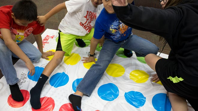 Playing Twister at the Boys & Girls Clubs of Metro Phoenix, Tri-City West/Thornwood Branch in Avondale, are (from left) Isaiah Murillo, Daniel Arenas, Oscar Ontiveros and Aaliyah Tabor.