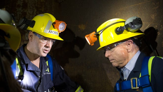 Sen. John McCain (right) talks with project director Andrew Taplin while riding 1,200 feet to the Resolution Copper Mine's surface.