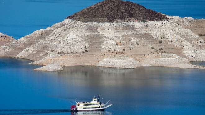 """Rock Island's """"bathtub ring"""" illustrates how the water level at Lake Mead has dropped. It is at 1,085 feet, 10 above a level that would trigger supply reductions."""