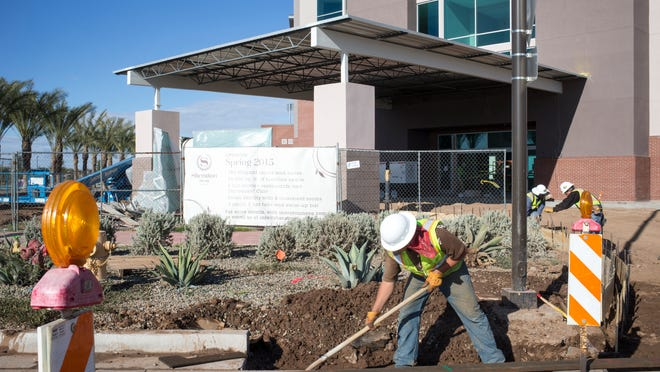 """Construction work continues on the Sheraton Mesa Hotel, February 23, 2015, at Mesa's """"Wrigleyville West"""" district next to the Chicago Cubs spring training stadium, 2330 W. Rio Salado Parkway, Mesa."""