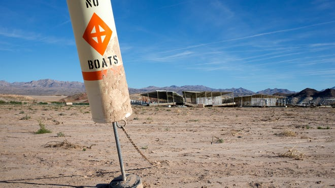 The Echo Bay Marina sits abandoned in the Lake Mead National Recreation Area in Nevada. By next year, the amount of Colorado River water flowing into Lake Mead could fall enough to trigger cuts in Arizona's allocation of river water by more than 320,000 acre-feet.