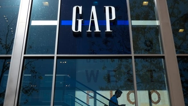 FILE - In this Tuesday, Feb. 26, 2013 file photo, a shopper walks down the steps at a Gap store in Los Angeles. The Gap Inc. reports quarterly financial results after the market closes on Thursday Aug. 22, 2013. (AP Photo/Jae C. Hong, File)