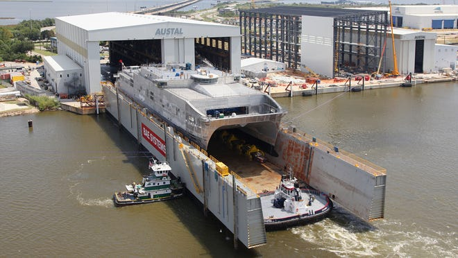 Top, the Military Sealift Command joint high speed vessel USNS Spearhead (JHSV 1), the first of 10 Navy joint high-speed vessels designed for rapid intra-theater transport of troops and military equipment, prepares for its Sept. 17 christening ceremony at Austal USA in Mobile, Ala.