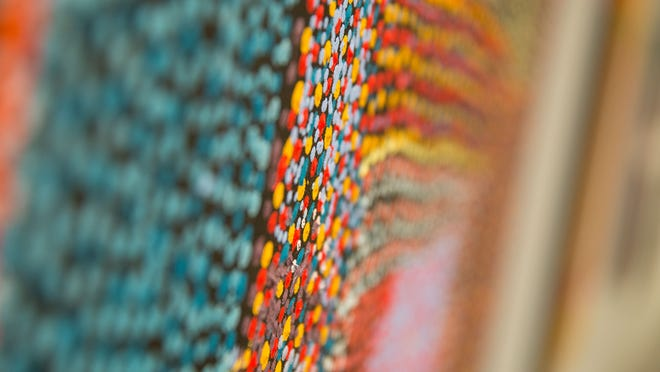 """A detail of this painting by Tommy Mitchell reveals the elaborate dot painting technique, one of the methods employed by the artists of """"No Boundaries: Aboriginal Australian Contemporary Abstract Painting,"""" on view through May 3 at the Nevada Museum of Art in Reno."""