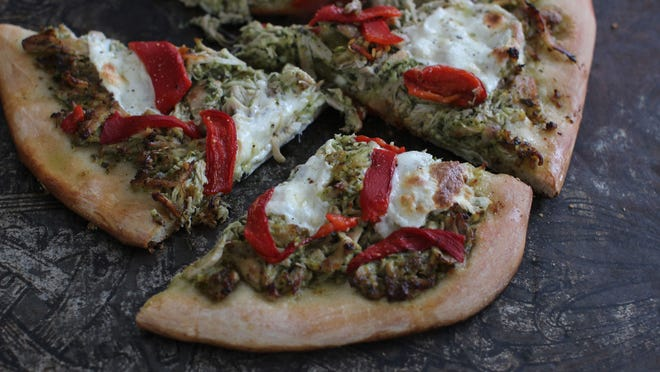 Pulled chicken pesto pizza is an innovative use of your slow cooker.