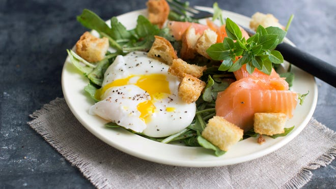 A poached egg adds to this Lyonnais-style salad with smoked salmon.