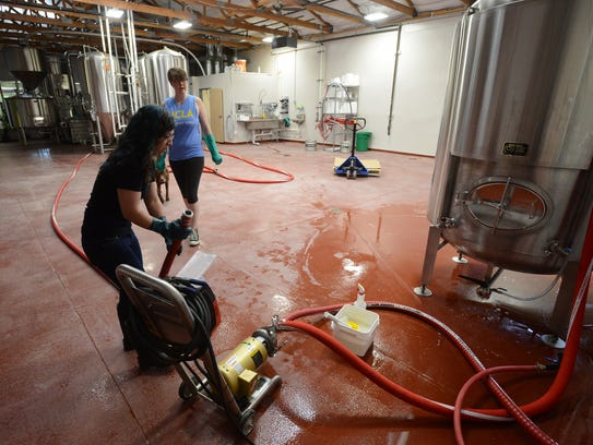 Head brewer, Linsey Cornish, and Trina Cochran, clean