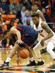 UTEP's Evan Gilyard, 3, takes the ball away from Anthony Adger of Florida Atlantic Thursday night.