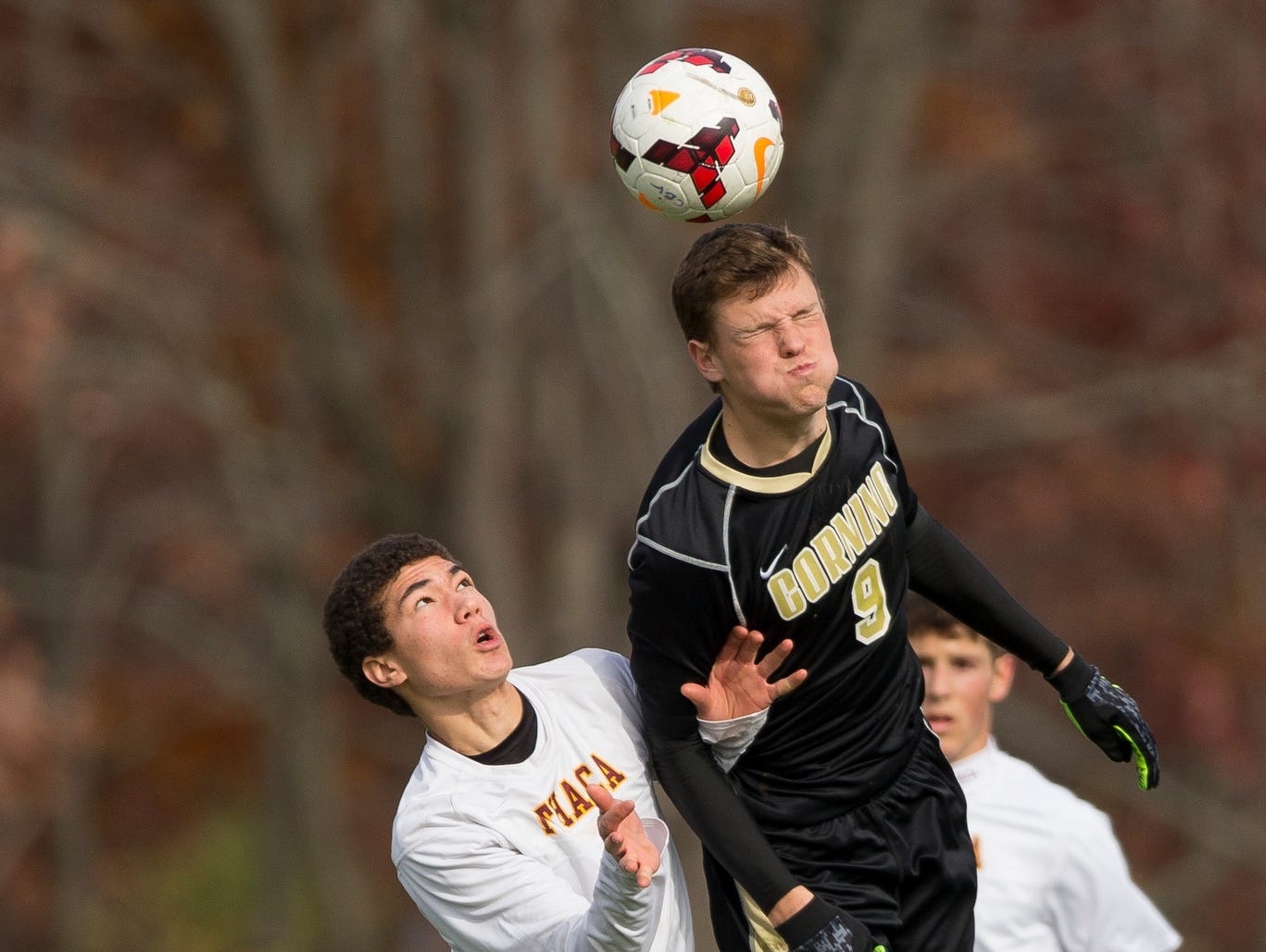 Ithaca's Mason Wolff, left, watches as Corning's Isaac Cornfield plays the ball Saturday during Ithaca's 2-0 win in the Section IV Class AA game in Oneonta.