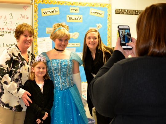 Hanna Stenzel, 9, poses for a photo with, from left, wish granter Lynn Behnke, Cinderella, played by Rachel Thuermer, and wish granter Lindsay Allen.