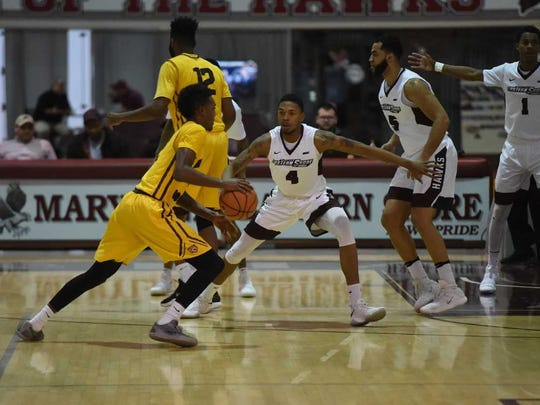 Colen Gaynor guards a player against Bethune-Cookman on Jan. 8, 2018.