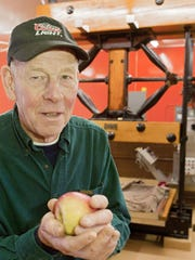 Bruce Hollenbeck makes apple cider at the family's Virgil business. Parts of the business's Boomer and Boschert press, made in Syracuse, are 70 years old.