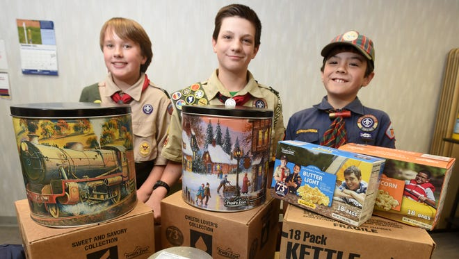 Andrew Grobler, 12, left, of Boy Scout Troop 325; Joe Paul, 12, of Boy Scout Troop 152; and Dominic Burnham, 10, of Cub Scout Pack 179, pose for a photo on Wednesday after being recognized for achieving the top popcorn sales figures in the region.