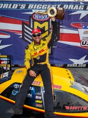 JR Todd celebrates after winning the Top Fuel event