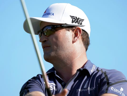 Zach Johnson follows his drive off the 14th tee box during the first round of the Sony Open golf tournament, Thursday, Jan. 11, 2018, in Honolulu. (AP Photo/Marco Garcia)
