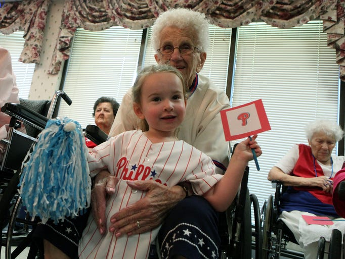 Millville Center resident Mary Randazzo with her great granddaughter Sloane Seeley, three of Bridgeton, during the staff/patient ballgame at Genesis Healthcare Millville Center, Monday, Jun. 16, 2014, in Millville.  Staff Photo/Sean M. Fitzgerald