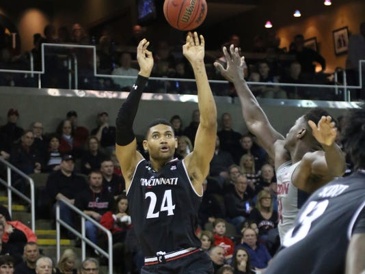 Cincinnati's Kyle Washington shoots during the first half of an NCAA college basketball game against Connecticut, Thursday, Feb. 22, 2018, in Highland Heights, Ky. (AP Photo/Tony Tribble)