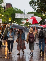 Jazz lovers dodge the rain on the opening evening of the Discover Jazz Festival in Burlington on Friday, June 5, 2015.