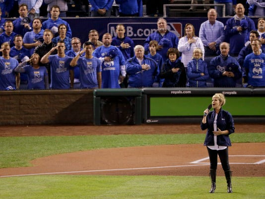 Classical soloist Joyce DiDonato sings the national anthem before Game 7 of baseball's World Series between the Kansas City Royals and the San Francisco Giants Wednesday, Oct. 29, 2014, in Kansas City, Mo. (AP Photo/Charlie Riedel)