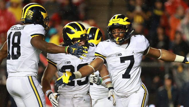 Michigan Wolverines' Khaleke Hudson (7) celebrates with teammate AJ Pearson  (18) after a tackle against Rutgers in 2016.