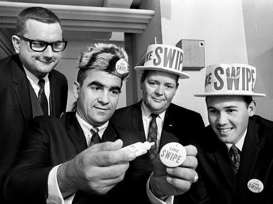 Swipe, the new dirt killer, is being demonstrated by Jack Frey, second from left, executive vice president of Homcare, a division of Chemical Associates of Houston that developed the cleaning fluid, Dec. 19, 1967. Looking on are Nashville representatives of the company, Doss Fisher, Cecil G. Gilliam and Larry Napier. The new cleaning fluid has been a financial boom to the company that discovered it and the demands for it here is very high.