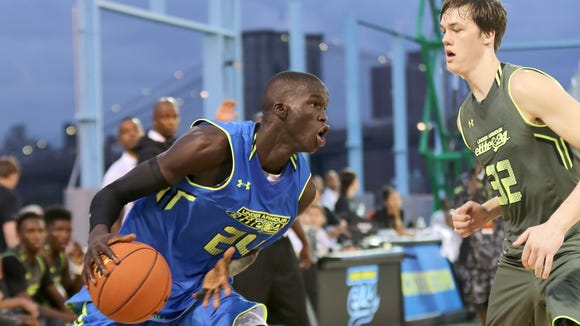 Team Freedom's Thon Maker #24 in action against Team Liberty during the Under Armour Elite 24 Game on Saturday, August 23, 2014 in Brooklyn, NY. (AP Photo/Gregory Payan)