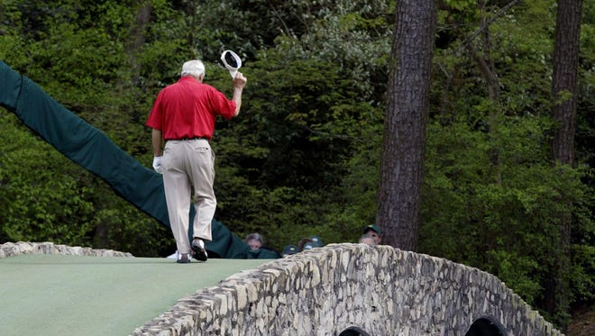 This April 9, 2004, file photo shows Arnold Palmer walking across the Hogan Bridge on the 12th fairway for the final time in Masters competition during the second round of the Masters golf tournament at the Augusta National Golf Club in Augusta, Ga.