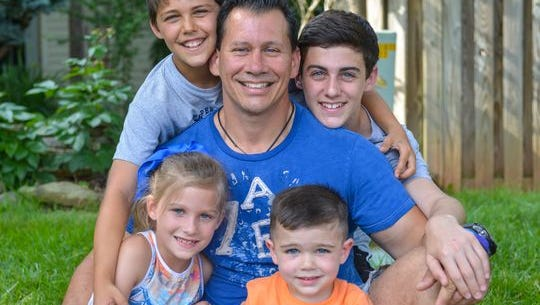 Kory Borde, 44, with his children (clockwise from top left): Cole, 11, Chance, 13, Carson, 3, and Ivy, 7. Borde divorced in 2006 and has full custody of his two sons from that marriage.